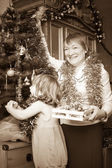Mature woman and child preparing for Christmas. — Stock Photo