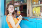 Pregnant woman buys fruits — Stock Photo
