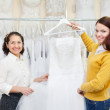 women chooses white gown  — Stock Photo
