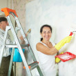 Smiling mature woman and man making repairs - Stock Photo