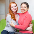 Happy mother and daughter hugging each other — Stock Photo