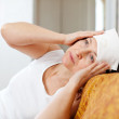 Woman stupes  towel to her head - Stock Photo