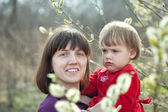 Mother with baby girl in spring willow — Stock fotografie