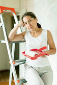 Weariness woman makes repairs — Stock Photo