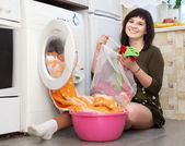 Housewife loading the washing machine — Стоковое фото