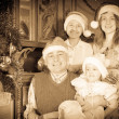 Happy family celebrating Christmas — Stock Photo #27493879
