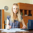 Stock Photo: Serious womworking with financial document