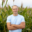 Happy farmer in field — Stock Photo