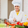 Cook works with vegetables at kitchen — Stock Photo #27490909