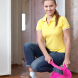 Woman sweeping the floor — Stock Photo #27490959
