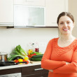 Positive woman in home kitchen — Stock Photo #27490967
