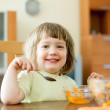 2 years child eats carrot salad — Stock Photo