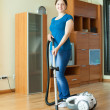 Stock Photo: Womcleans with vacuum cleaner