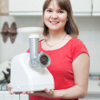 Stock Photo: Womwith electric grinder