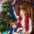Stock Photo: Mature womand baby during Christmas