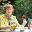 Mature woman with glass of red wine — Stock Photo