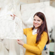 Woman chooses wedding dress — Stockfoto