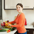 Smiling pretty woman washing fresh vegetables — Stock Photo #27491399