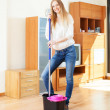 Cheeful ordinary woman washing parquet  with mop — Stockfoto