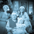 Old photo of happy  family posing for Christmas portrait — Stock Photo
