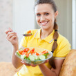 Stock Photo: Smiling healthy girl eating veggie salad