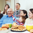 Happy multigeneration family or group of friends — Stock Photo #27491733