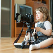 Baby  takes photo with camera and tripod — Stock Photo