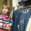 Two-year child at clothes shop — Stock Photo