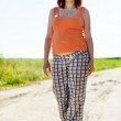 pregnant woman walking on  summer field — Stockfoto
