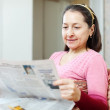Positive woman reading newspaper — Stock Photo