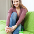 Happy woman looks to her toenails — Stock Photo