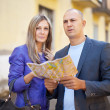 Stock Photo: Tourist couple looking at map