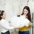 Two happy women chooses bridal outfit — Stock Photo