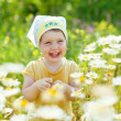 Stock Photo: Happy girl in daisy meadow