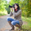 Photographer takes photo outdoor — Stock fotografie