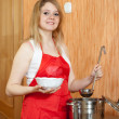 Woman with saucepan — Stock Photo
