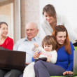 Stock Photo: Family enjoys on sofwith laptops