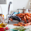 Heap of fresh raw seafoods and spices — Stock Photo #27492491