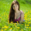 Stock Photo: Womrelaxing outdoor in meadow