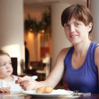 Stock Photo: Family having breakfast in restaurant