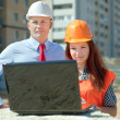 two builders works at construction site  — Stock Photo