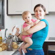 Happy mother with child  in kitchen — Stock Photo