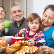 Family drinks tea with baked at home — Stock Photo
