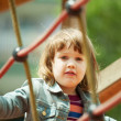 Stock Photo: Baby girl climbing at ropes