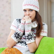 Stock Photo: Girl relaxing at home in winter