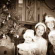 Vintage photo of happy family at Christmas time — Stock Photo #27492971