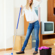 Fatigue long-haired girl washing parquet floor — Stock Photo
