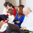 Happy family using few laptops — Stock Photo