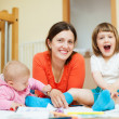 Stock Photo: Happy mother with children home