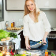 woman cooking fish in sheet pan — Stock Photo